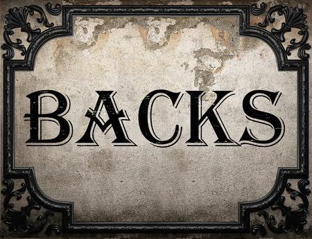 backs: backs word on concrette wall Stock Photo