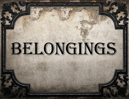 belongings: belongings word on concrette wall