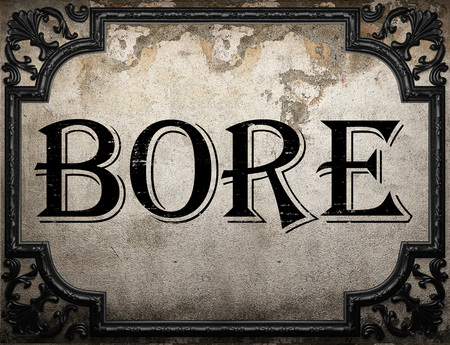 bore: bore word on concrette wall Stock Photo