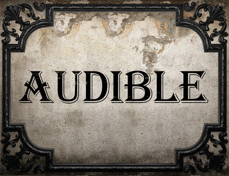 audible: audible word on concrette wall