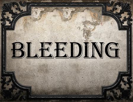 bleeding: bleeding word on concrette wall