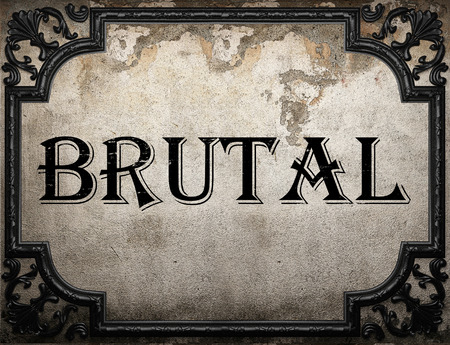 brutal: brutal word on concrette wall Stock Photo