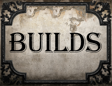 builds: builds word on concrette wall