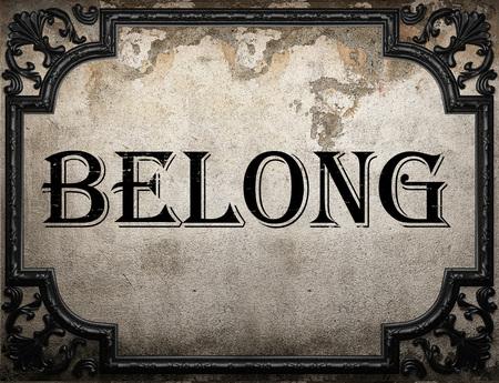 belong: belong word on concrette wall