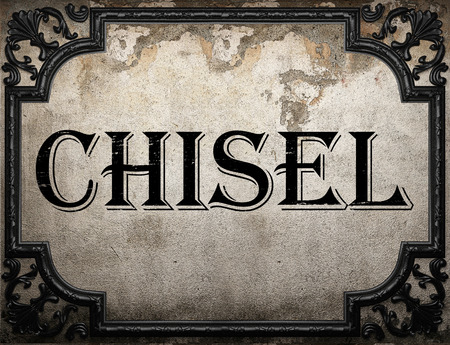 chisel: chisel word on concrette wall