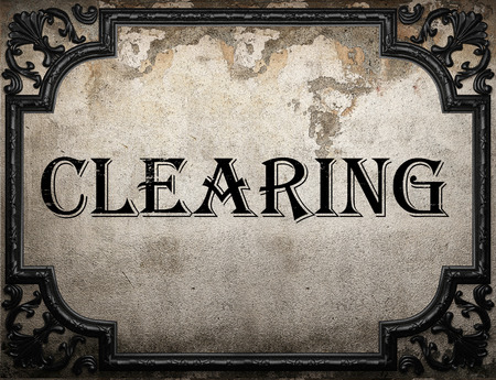 clearing: clearing word on concrette wall
