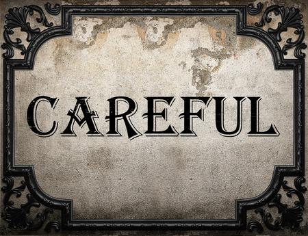 careful: careful word on concrette wall Stock Photo