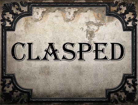 clasped: clasped word on concrette wall Stock Photo