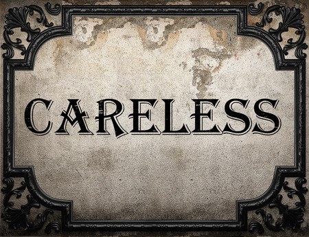 careless: careless word on concrette wall Stock Photo
