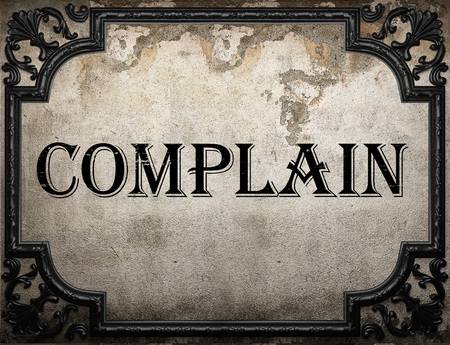 complain: complain word on concrette wall Stock Photo