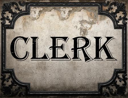 the clerk: palabra empleado en la pared concrette