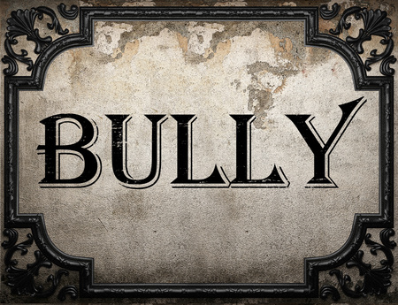 bully: bully word on concrette wall Stock Photo
