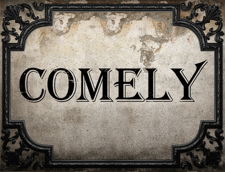 comely: comely word on concrette wall Stock Photo
