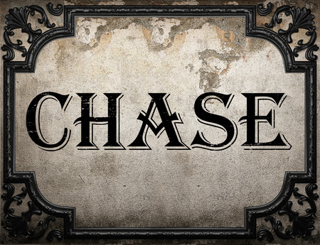 chase: chase word on concrette wall Stock Photo