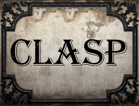 to clasp: clasp word on concrette wall