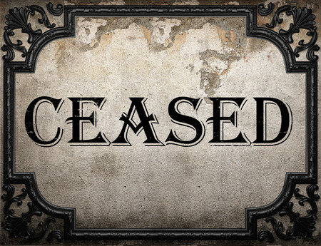 ceased: ceased word on concrette wall Stock Photo