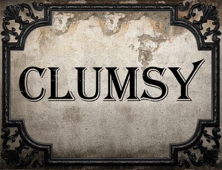 clumsy: clumsy word on concrette wall