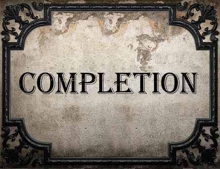 completion: completion word on concrette wall Stock Photo