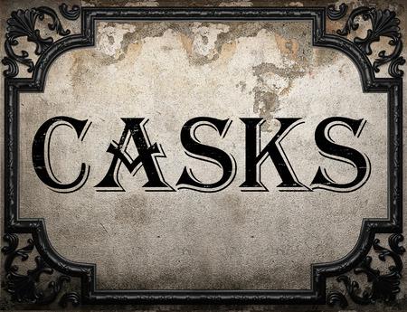 casks: casks word on concrette wall Stock Photo