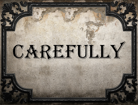 carefully: carefully word on concrette wall