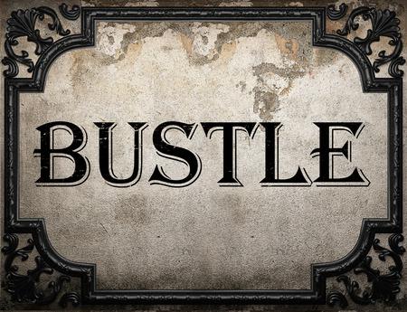 bustle: bustle word on concrette wall
