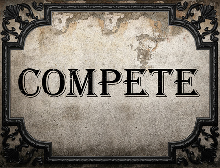 compete: compete word on concrette wall