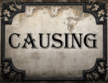 causing: causing word on concrette wall