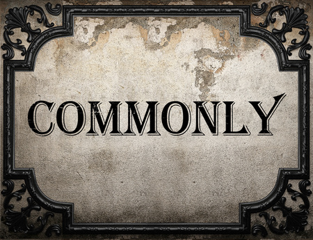 commonly: commonly word on concrette wall Stock Photo
