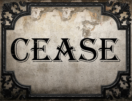 cease: cease word on concrette wall