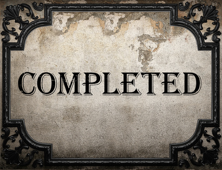 completed: completed word on concrette wall Stock Photo