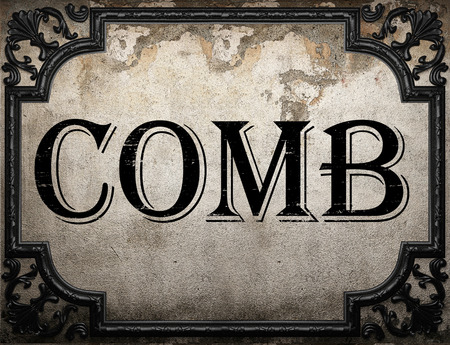 comb: comb word on concrette wall