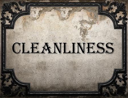 aseo: palabra limpieza en la pared concrette Foto de archivo