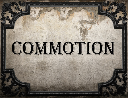 commotion: commotion word on concrette wall