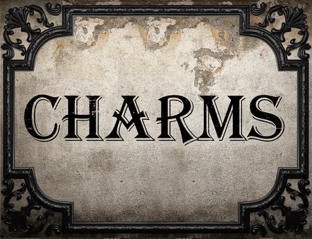 charms: charms word on concrette wall
