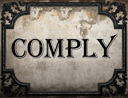 comply: comply word on concrette wall