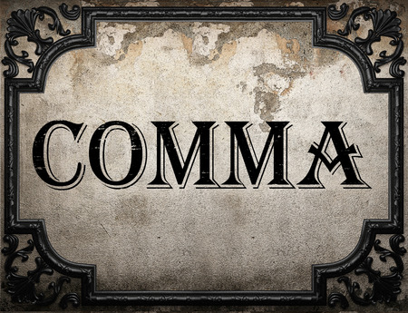 and comma: comma word on concrette wall