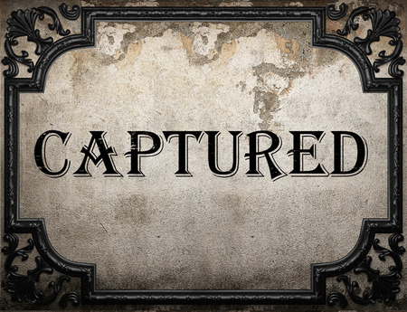 captured: captured word on concrette wall Stock Photo