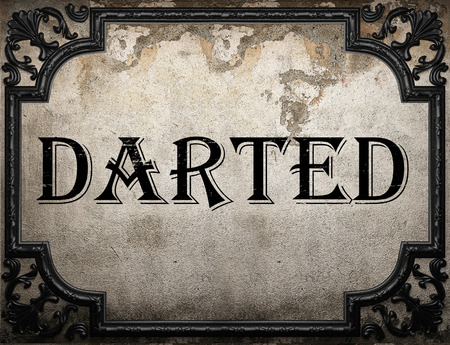 darted: darted word on concrette wall