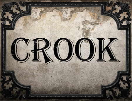 crook: crook word on concrette wall