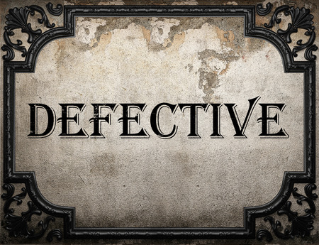 defective: defective word on concrette wall Stock Photo