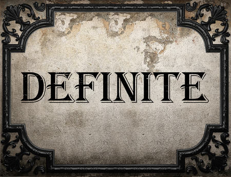 definite: definite word on concrette wall