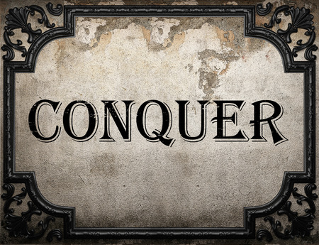 conquer: conquer word on concrette wall Stock Photo