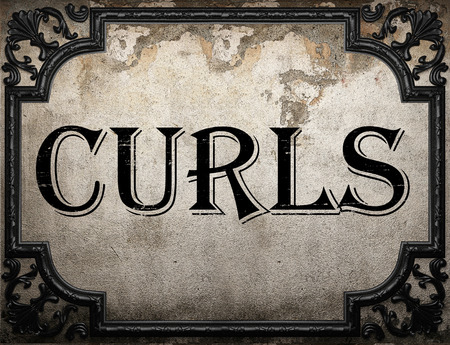 curls: curls word on concrette wall
