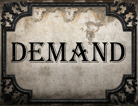 demand: demand word on concrette wall Stock Photo