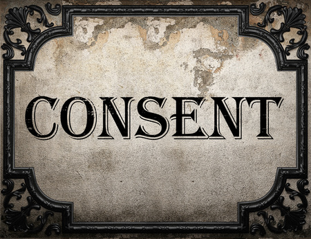 consent: consent word on concrette wall Stock Photo