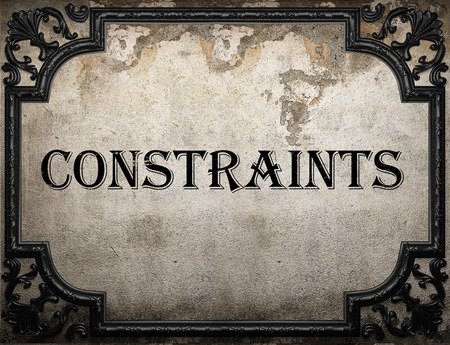 constraints: constraints word on concrette wall Stock Photo