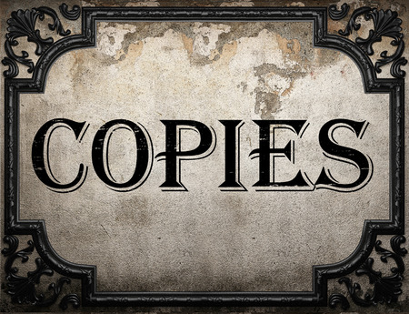 copies: copies word on concrette wall