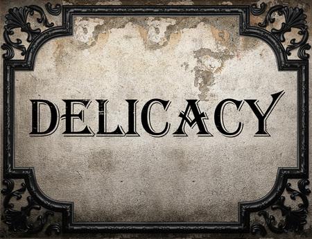 manjar: palabra delicadeza en la pared concrette Foto de archivo