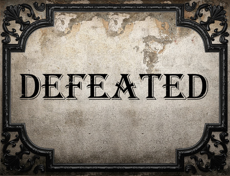 defeated: defeated word on concrette wall