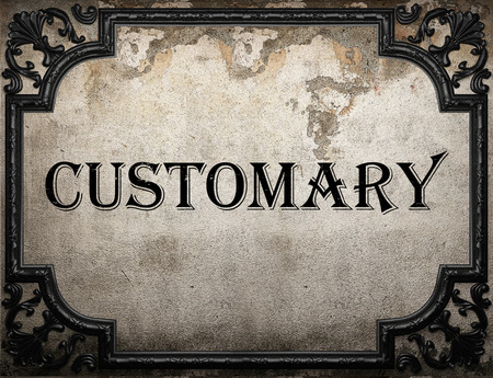 customary: customary word on concrette wall